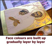 Face colours are built up gradually layer by layer